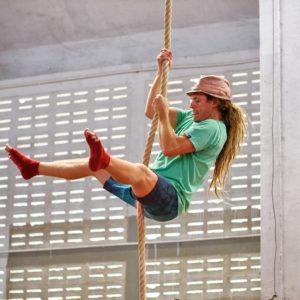 Sam Salwei climbing a rope