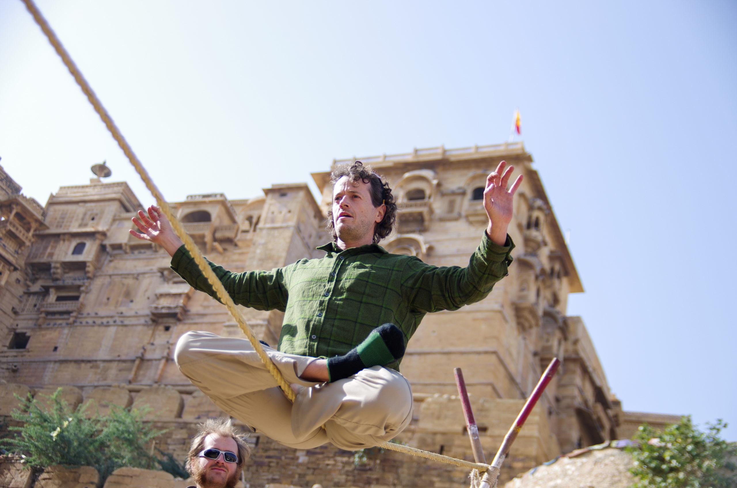 Jason Magness balancing on a slack rope